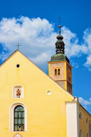 Franciscan Church of St John the Baptist in Old city of Varazdin in Croatia. Panorama and Cityscape with Cathedral in famous Croatian town in Europe in summer. Blue sky with clounds on background