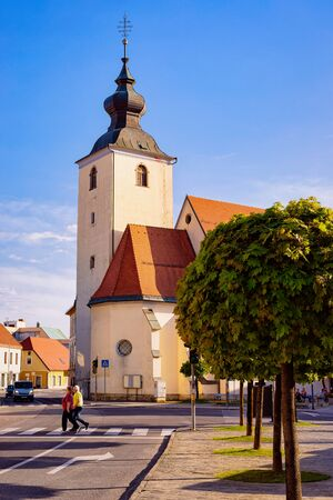 Main Liberty square with crossroads at Our Lady of the Seven Sorrows Church in Old center in Slovenska Bistrica near Maribor in Slovenia. City in South Styria in Slovenija. Bell tower of Cathedral