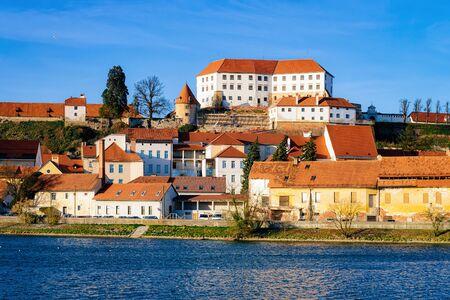 Cityscape of Ptuj Castle with old town at Drava River in Slovenia. Architecture in Slovenija. Travel Stock Photo