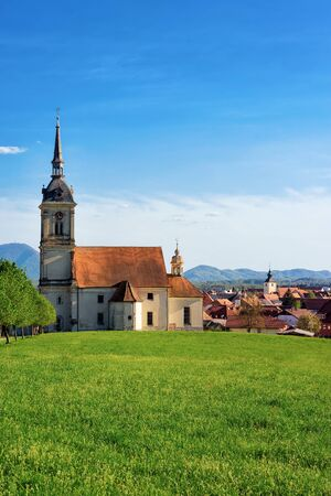 Saint Bartholomew Parish Church and scenery in Old center of Slovenska Bistrica near Maribor in Slovenia. City travel in South Styria in Slovenija. Bell tower of Cathedral in Slovenian town.