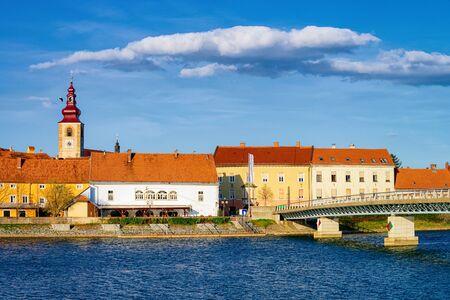 Cityscape of Ptuj Castle and bridge at old town at Drava River in Slovenia. Architecture in Slovenija. Travel