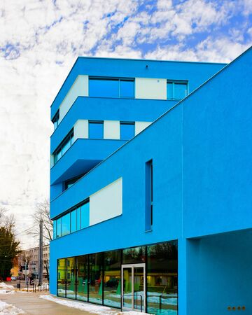 Apartment in residential building exterior. Housing structure at blue modern house of Europe. Rental home in city district on summer. Architecture for business property investment, Salzburg Austria.