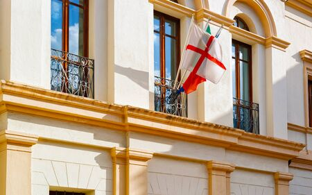 Flags at Municipal building architecture in Old city of Olbia reflex Imagens