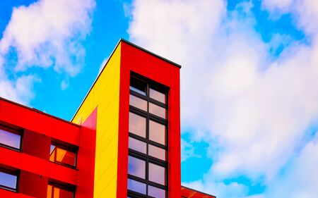 Part of modern apartment house copy space blue sky clouds reflex