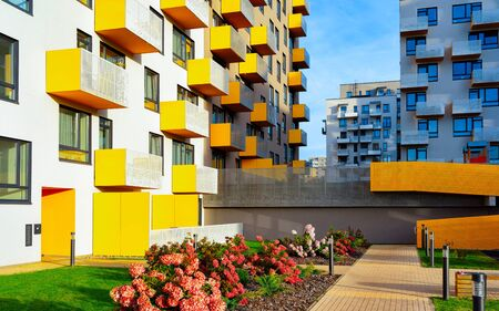 Apartment residential modern house building exterior with flowers and gate reflex 版權商用圖片