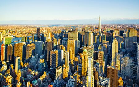 Aerial panoramic view. on Midtown district of Manhattan in New York. Hudson river is on the background. Metropolitan City skyline, USA. American architecture building. Panorama of Metropolis NYC