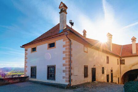 Sunset in Ptuj Castle in Slovenia. Facade of Building architecture in Ptujski grad in Slovenija.