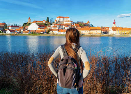 Young girl with backpack at Ptuj Castle Slovenia