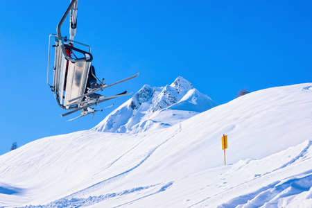 Skiers in Chair lifts at Hintertux Glacier in Austria