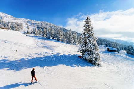 Man on Snowboard in Zillertal Arena ski resort in Austria