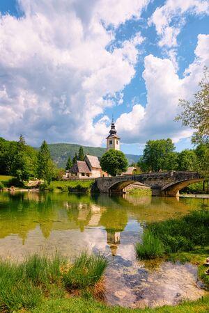 Scenery with Church Saint John Baptist Bohinj Lake of Slovenia Stock Photo