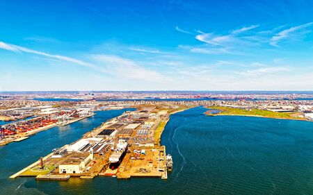 Aerial view of Dry Dock and Repair and Port Newark and Global international shipping containers, Bayonne, New Jersey. NJ, USA. Harbor cargo. Staten Island with St George Ferry terminal, New York City Stok Fotoğraf