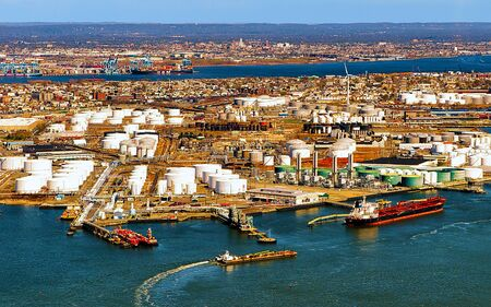 Aerial view of Dry Dock and Repair and Port Newark and Global international shipping containers, Bayonne, New Jersey. NJ, USA. Harbor cargo. Staten Island with St George Ferry terminal, New York City Stock Photo