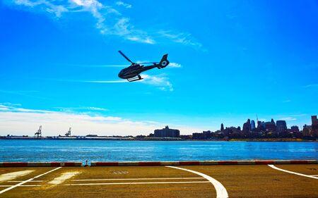 Black Helicopter over helipad in Lower Manhattan reflex