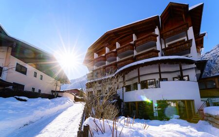 House architecture in Mayrhofen at Zillertal valley Tirol Austria sunny reflex