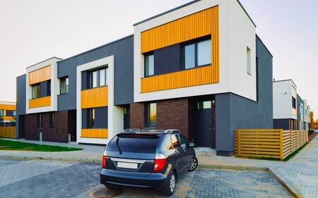 Apartment modern town house residential building and car parked reflex