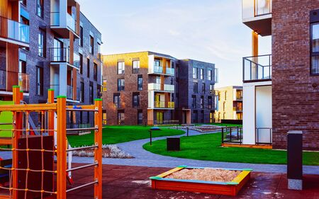 Residential apartment house building exterior children playground reflex