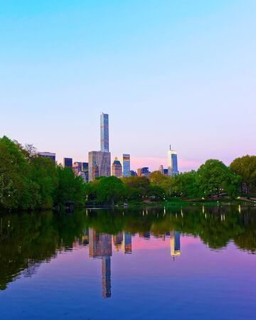 Pond at Central park New York, great design for any purposes. Midtown Manhattan, USA. View with Skyline of Skyscrapers architecture in NYC. Nature background. Urban cityscape. NY, US Stock Photo