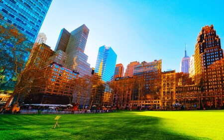 Skyline with skyscrapers and American cityscape in Bryant Park in Midtown Manhattan, New York, USA. United States of America. NYC, US.