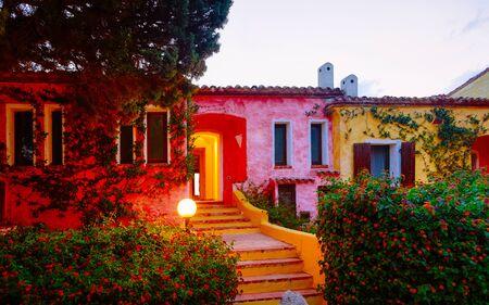 Houses at Baja Sardinia luxury resort at night in Sardinia reflex