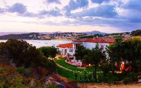 Landscape and scenery of Baja Sardinia luxury resort at night reflex