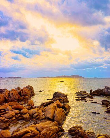 Romantic sunrise at Capriccioli Beach in Costa Smeralda reflex
