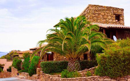Cottage with Palm trees at Capo Coda Cavallo reflex