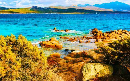 Sunrise and Rocks at Capriccioli Beach in Costa Smeralda Sardinia reflex