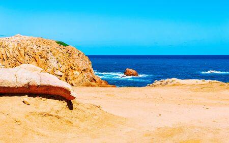 Beach near the Mediterranean sea in Buggerru province reflex