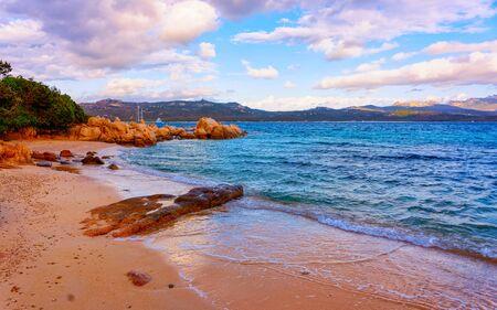 Romantic morning sunrise at Capriccioli Beach in Costa Smeralda reflex