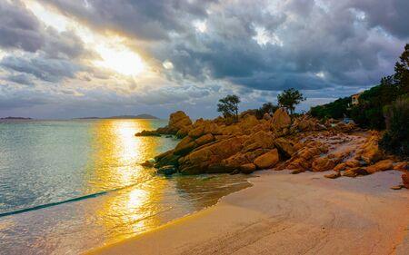 Romantic sunrise in Capriccioli Beach in Costa Smeralda reflex Standard-Bild