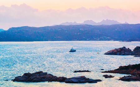 Sunrise with ship in Baja Sardinia at Mediterranean sea Sardinia reflex