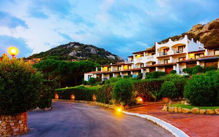 Houses at Baja Sardinia luxury resort at night on Sardinia reflex