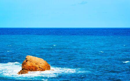 Capo Pecora beach in Mediterranean Sea in Sardinia reflex