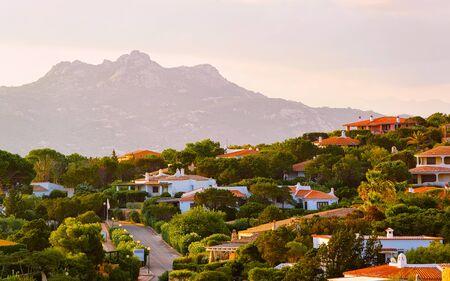 Baja Sardinia resort on Costa Smeralda at sunset reflex