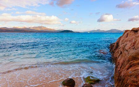 Romantic morning sunrise in Capriccioli Beach in Costa Smeralda reflex