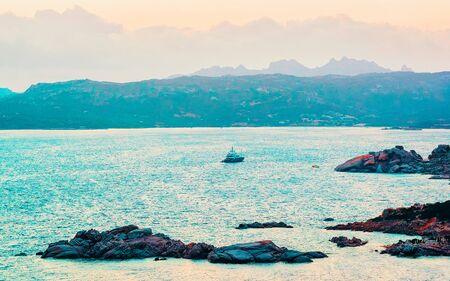 Capo Ferro in Mediterranean Sea Costa Smeralda Italy reflex