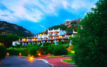 Baja Sardinia resort at Costa Smeralda in evening reflex Standard-Bild