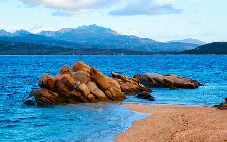 Romantic morning at Capriccioli Beach in Costa Smeralda reflex