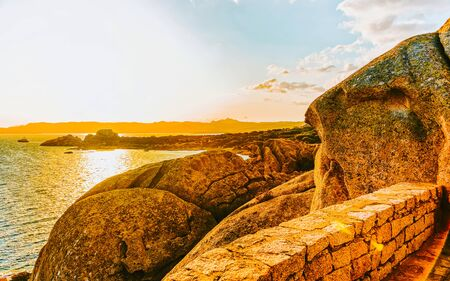Sunset at Capo Ferro on Mediterranean Sea Costa Smeralda Italy reflex