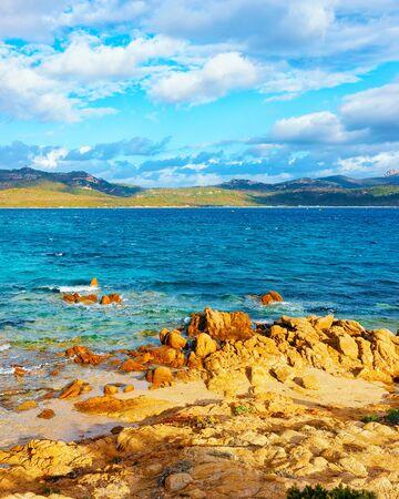 Romantic sunny sunrise on Capriccioli Beach of Costa Smeralda reflex