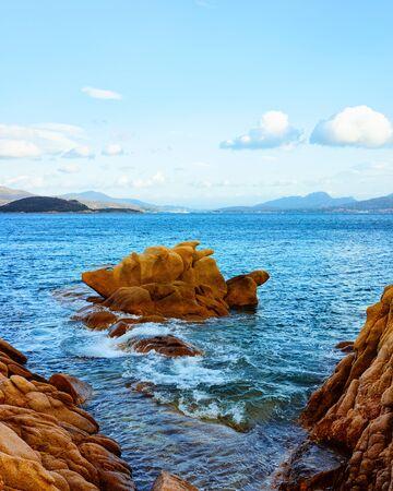 Romantic morning sunrise on Capriccioli Beach of Costa Smeralda reflex