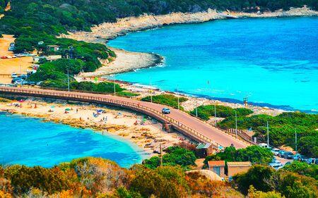Scenery with road and beach at Santa Teresa Gallura reflex
