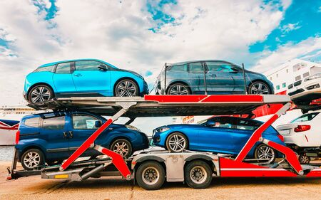 Car transporter in port of Cagliari Sardinia Island Italy reflex