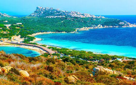 Scenery with road and beach Santa Teresa Gallura reflex Stock Photo