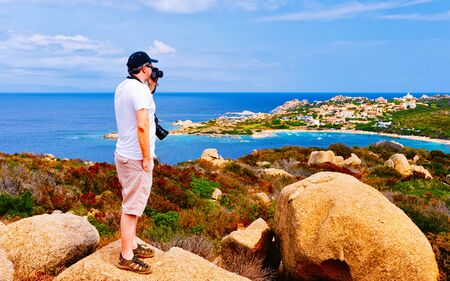 Man and Landscape with Rocky coast of Capo Testa in Santa Teresa Gallura at the Mediterranean Sea on Sardinia Island in Summer Italy. Scenery of Cagliari province. Mixed media.