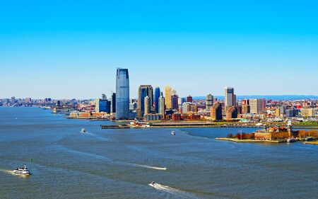 Aerial view of the Governors Island with Brooklyn in the background reflex
