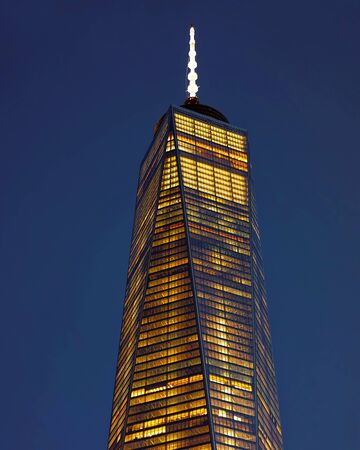 Close up of top facade of Freedom Tower in Lower Manhattan reflex