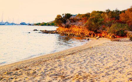 Landscape with Sunrise or sunset at beach on Mediterranean sea in Porto Rotondo on Costa Smeralda in Sardinia island, Italy. Sardegna in summer. Olbia province. Mixed media.