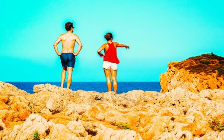 Couple and Landscape of Chia Beach and Blue Waters of the Mediterranean Sea in Province of Cagliari in South Sardinia in Italy. Scenery and nature. Mixed media.